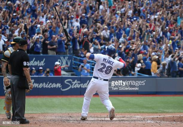 Steve Pearce of the Toronto Blue Jays flips his bat after hitting a gamewinning grand slam home run in the tenth inning during MLB game action...