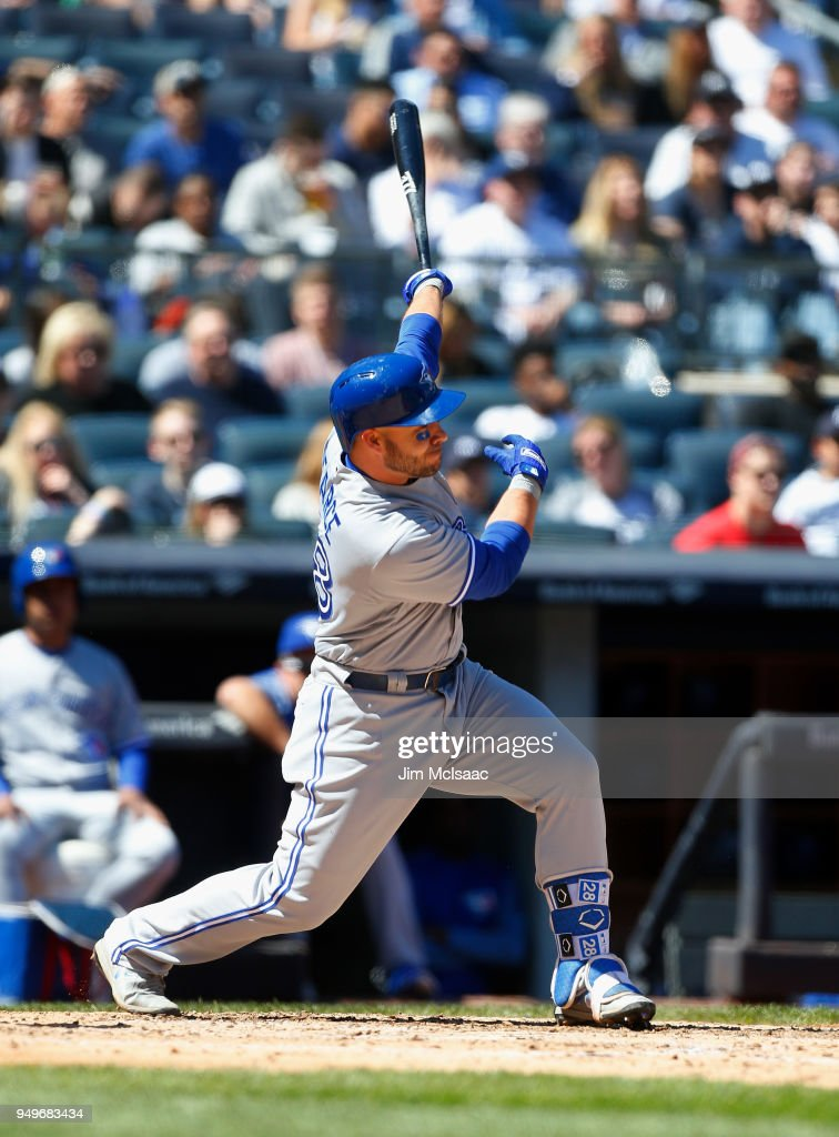 Steve Pearce #28 of the Toronto Blue Jays follows through on a fifth inning RBI single against the New York Yankees at Yankee Stadium on April 21, 2018 in the Bronx borough of New York City.