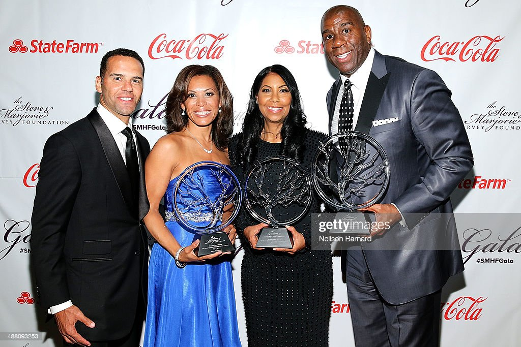Steve Pemberton, Tonya Pemberton, Cookie Johnson, and Earvin 'Magic' Johnson pose with their awards at the 2014 Steve & Marjorie Harvey Foundation Gala presented by Coca-Cola at the Hilton Chicago on May 3, 2014 in Chicago, Illinois.