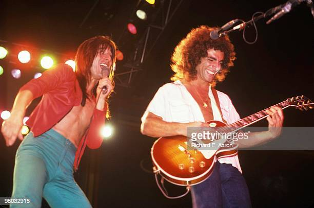 Steve Perry and Neal Schon of Journey perform on stage in New York in 1980.