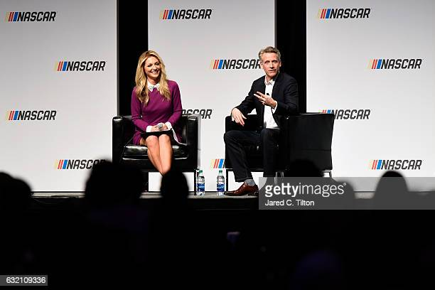Steve Phelps chief marketing officer for NASCAR and emcee Danielle Trotta speak during the NASCAR Marketing and Communications Summit on January 19...