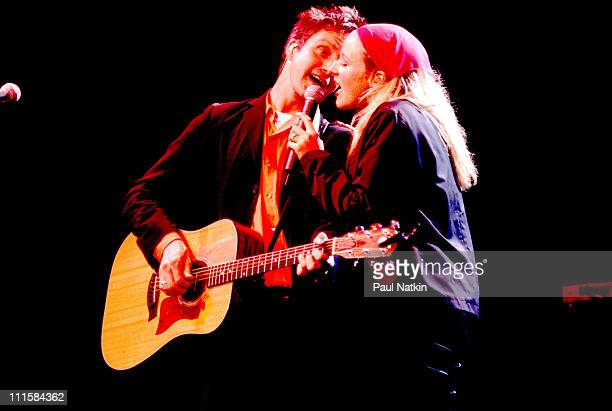 Steve Poltz performing with Jewel on stage at the Tweeter Center in Tinley Park Illinois August 12 1999