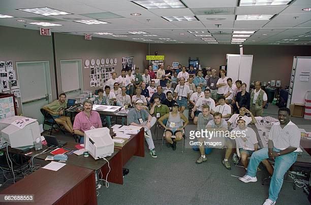 Steve Powell and the Allsport photographer and editor team in the Allsport office of the media centre during the XXVI Summer Olympic Games on 3...