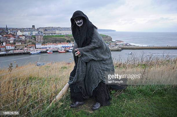 Steve Price a construction worker from Chesterfield comes dressed as the 'Reaper' to the Goth weekend on November 2 2013 in Whitby England The Whitby...