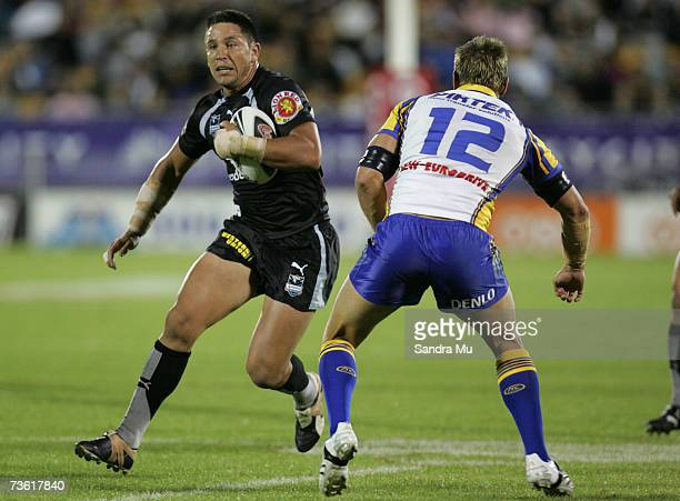 Steve Price of the Warriors runs around Chad Robinson of Parramatta during the round one NRL match between the Warriors and the Parramatta Eels at...