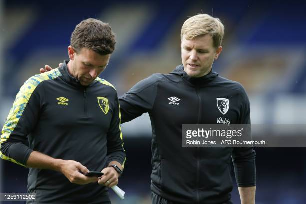Steve Purches and Eddie Howe of Bournemouth leave the pitch after their side are relegated after the Premier League match between Everton FC and AFC...