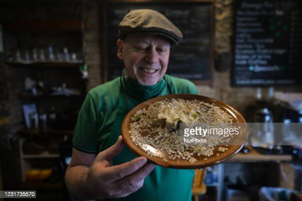 Steve Quilligan holds ready to cook a Beef and Guinness Potato Cake in the form of a shamrock inside the Irish Potato Cake Company restaurant in...