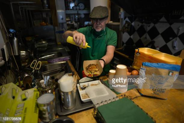 Steve Quilligan prepares a Beef and Guinness Potato Cake in the form of a shamrock inside the Irish Potato Cake Company restaurant in Dublin's city...