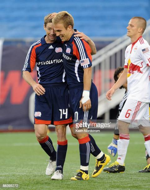 Steve Ralston congratulates teammate Taylor Twellman of the New England Revolution on his second goal of the match against the New York Red Bulls...