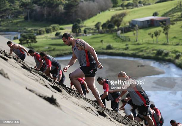 Steve Rapira of the Warriors trains on the sand dunes during the New Zealand Warriors NRL training session at Bethells Beach on November 10 2012 in...