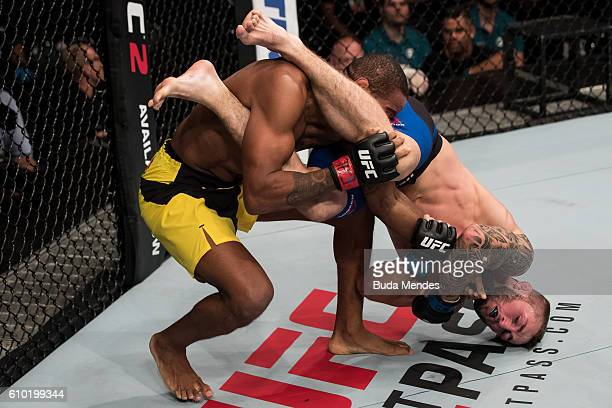 Steve Ray of Scotland controls the body of Alan Patrick of the Brazil in their lightweight bout during the UFC Fight Night event at Nilson Nelson...