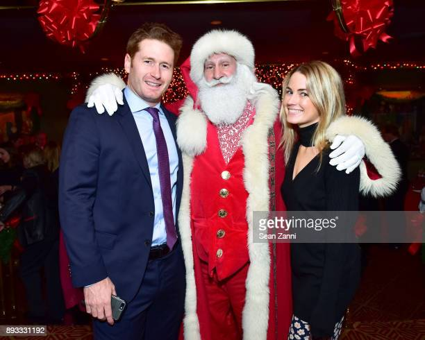 Steve Read Santa Claus and Amanda Hearst attend A Christmas Cheer Holiday Party 2017 Hosted by George Farias and Anne and Jay McInerney at The...