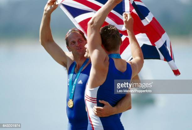 Steve Redgrave and other members of the men's coxless four team of Great Britain after winning the gold medal in their event during the Summer...