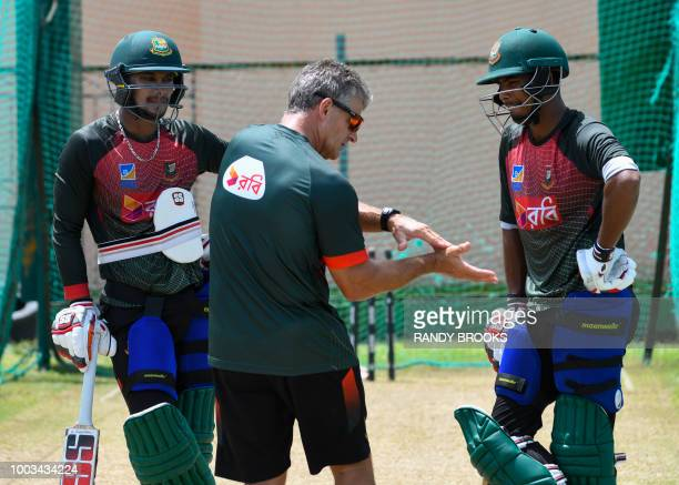 Steve Rhodes chats with Sabbir Rahman and Mosaddek Hossain of Bangladesh while taking part in a training session one day ahead of the 1st ODI match...
