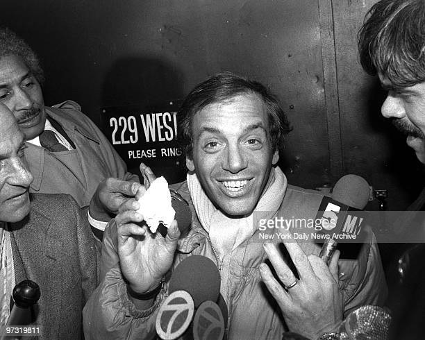 Steve Rubell holds piece of plaster as he talks to the reporters after federal agents raided his Studio 54 He claimed raiders damaged a wall during...