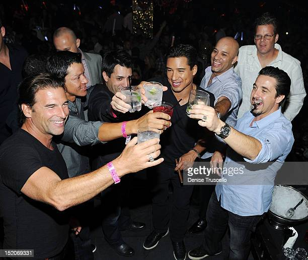Steve Santagati Mario Lopez and Tuddy Rinks celebrate Mario Lopez's bachelor party at TAO Nightclub at the Venetian on September 15 2012 in Las Vegas...