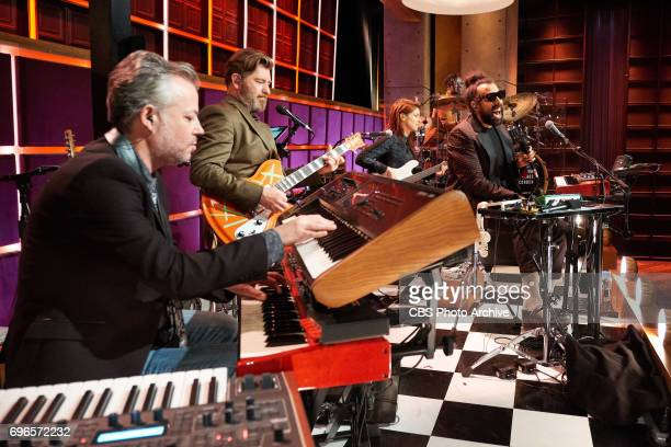 Steve Scalfati Tim Young Hagar Ben Ari Guillermo Brown and Reggie Watts of the Late Late Show band perform during The Late Late Show with James...