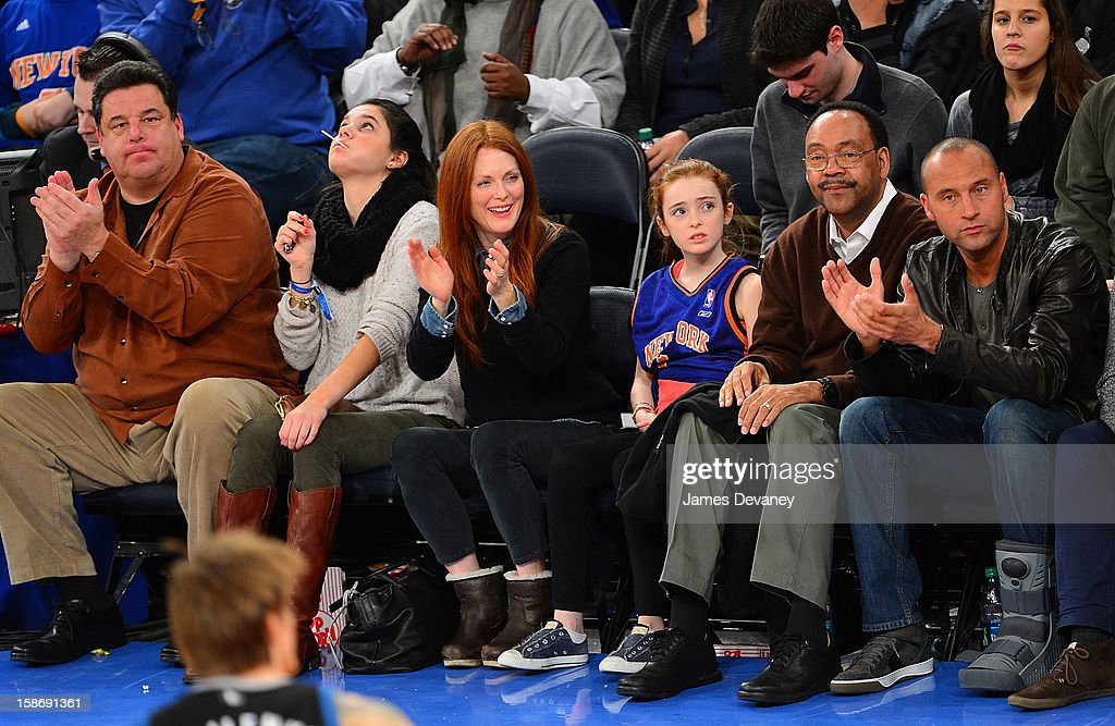Steve Schirripa, guest, Julianne Moore, Liv Helen Freundlich, Sanderson Jeter and Derek Jeter attend the Minnesota Timberwolves vs New York Knicks game at Madison Square Garden on December 23, 2012 in New York City.