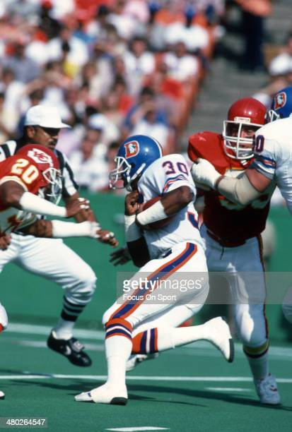 Steve Sewell of the Denver Broncos carries the ball against the Kansas City Chiefs during an NFL football game October 27 1985 at Arrowhead Stadium...