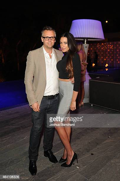 Steve Shaw and guest attend the Treats Magazine PreOscar Party at the Treats Villa presented by OMNIA on February 21 2015 in Los Angeles California