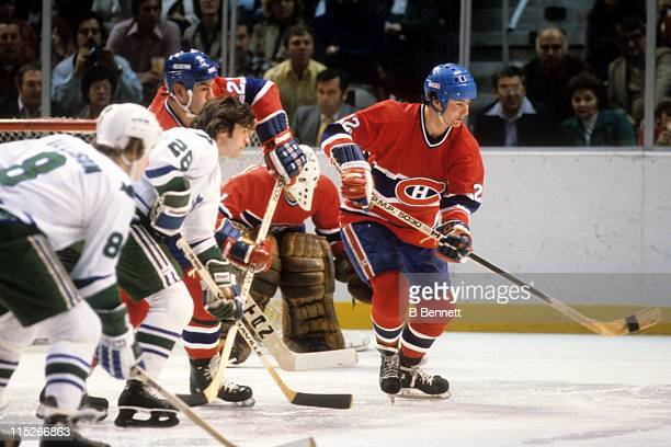Steve Shutt and Bob Gainey of the Montreal Canadiens along with Pat Boutette and Ray Allison of the Hartford Whalers wait for the faceoff during...