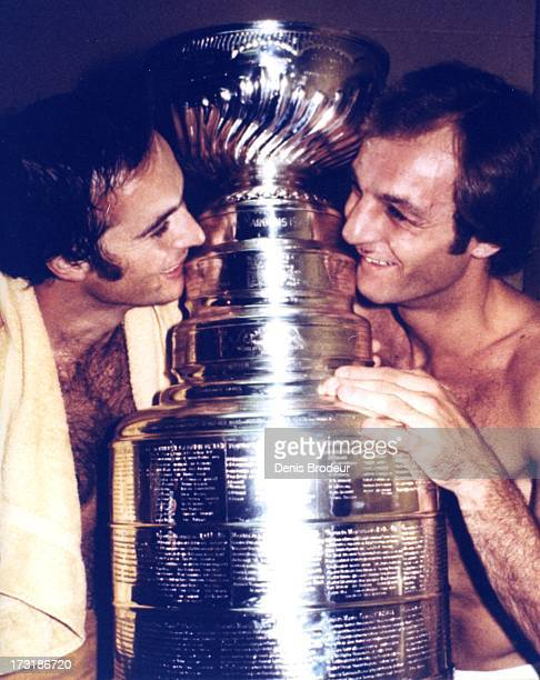 Steve Shutt and Guy Lafleur of the Montreal Canadiens pose with the Stanley Cup circa 1970 in Montreal Quebec Canada