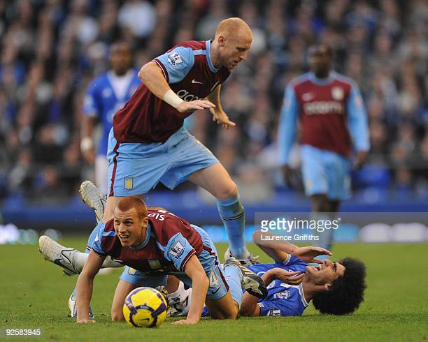 Steve Sidwell and James Collins of Aston Villa battles with Marouane Fellaini of Everton during the Barclays Premier League match between Everton and...