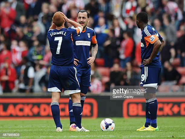 Steve Sidwell Konstantinos Mitroglou and Darren Bent of Fulham react as their side concedes a third goal during the Barclays Premier League match...