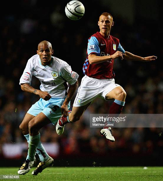 Steve Sidwell of Aston Villa and Clarke Carlisle of Burnley challenge for the ball during the Carling Cup Fourth Round match between Aston Villa and...