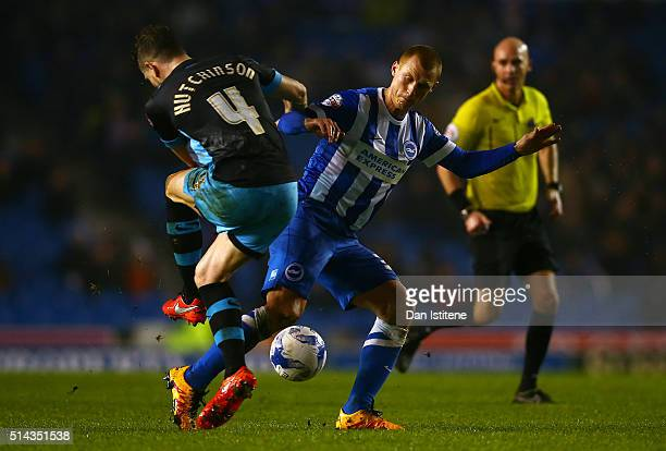 Steve Sidwell of Brighton and Hove Albion battles for the ball with Sam Hutchinson of Sheffield Wednesday during the Sky Bet Championship match...