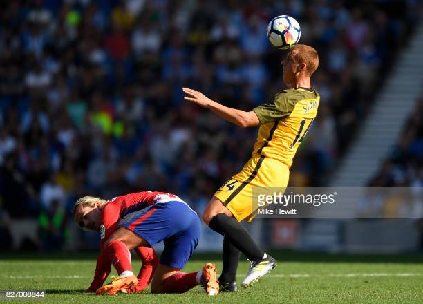Steve Sidwell of Brighton battles Antoine Griezmann of Atletico Madrid during a Pre Season Friendly between Brighton Hove Albion and Atletico Madrid...