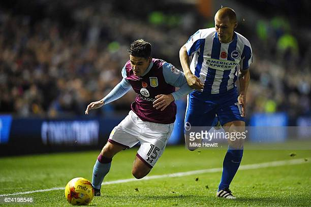 Steve Sidwell of Brighton challenges Ashley Westwood of Aston Villa during the Sky Bet Championship match between Brighton Hove Albion and Aston...