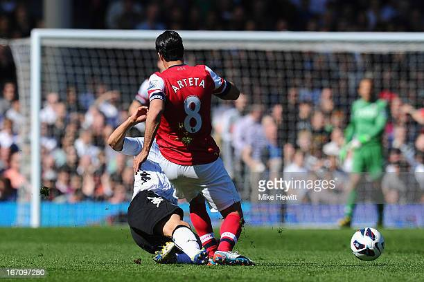 Steve Sidwell of Fulham tackles Mikel Arteta of Arsenal and is sent off for serious foul play during the Barclays Premier League match between Fulham...