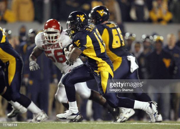 Steve Slaton of the Virginia Mountaineers carries the ball during the game against the Rutgers Scarlet Knights at Milan Puskar Stadium December 2...