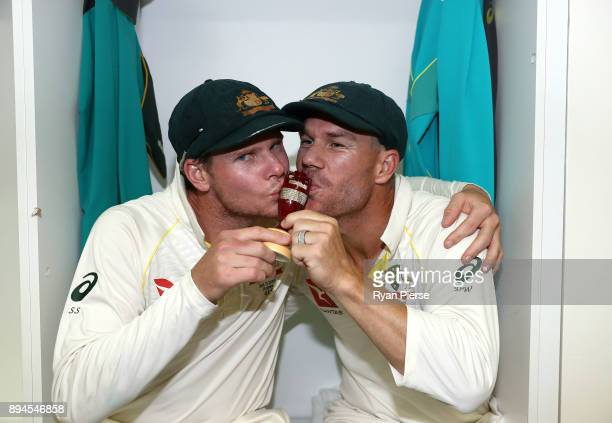 Steve Smith and David Warner of Australia celebrate in the changerooms after Australia regained the Ashes during day five of the Third Test match...