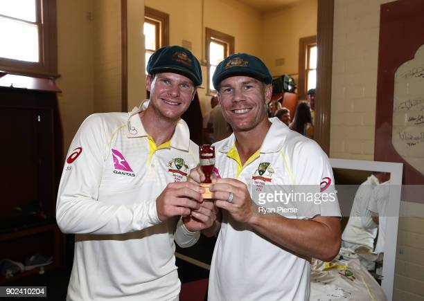 Steve Smith and David Warner of Australia celebrate with the Ashes Urn in the change rooms during day five of the Fifth Test match in the 2017/18...