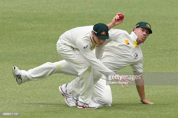 Steve Smith and David Warner of Australia collide whilst fielding during day four of the Third Ashes Test Match between Australia and England at WACA...
