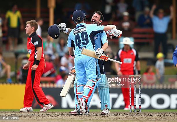 Steve Smith and Ed Cowan of the Blues celebrate after hitting the winning runs during the Matador BBQs One Day Cup final match between New South...