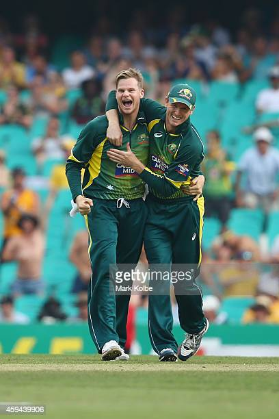Steve Smith and George Bailey of Australia celebrate Smith taking the wicket of David Miller of South Africa during game five of the One Day...