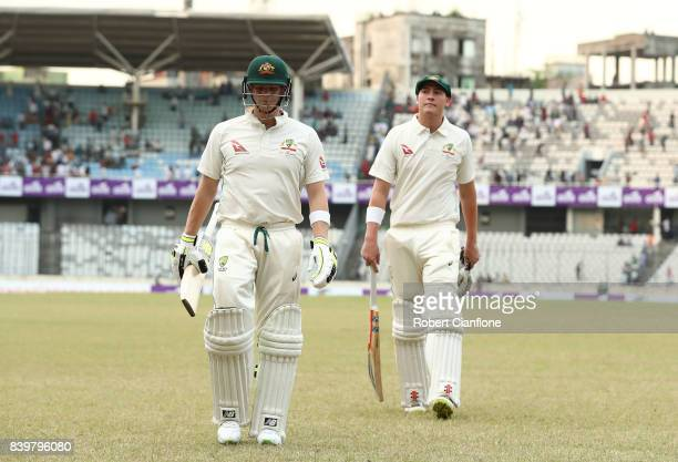 Steve Smith and Matthew Renshaw of Australia walk off the ground at the end of play during day one of the First Test match between Bangladesh and...