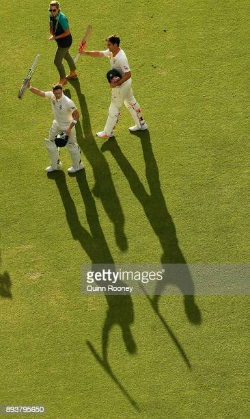 Steve Smith and Mitch Marsh of Australia walk off the field after a 300 run partnership during day three of the Third Test match during the 2017/18...