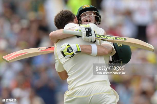 Steve Smith and Mitchell Marsh of Australia celebrate after Marsh reached his century on the third day of the third Ashes cricket test match between...
