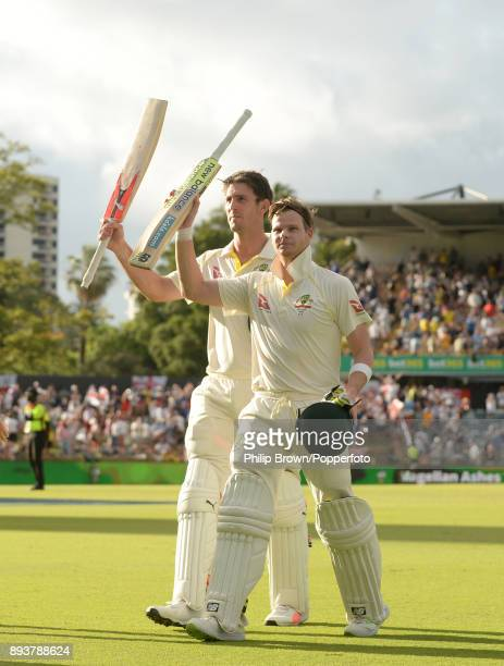 Steve Smith and Mitchell Marsh of Australia leave the field after their unbeaten partnership of 301 runs on the third day of the third Ashes cricket...