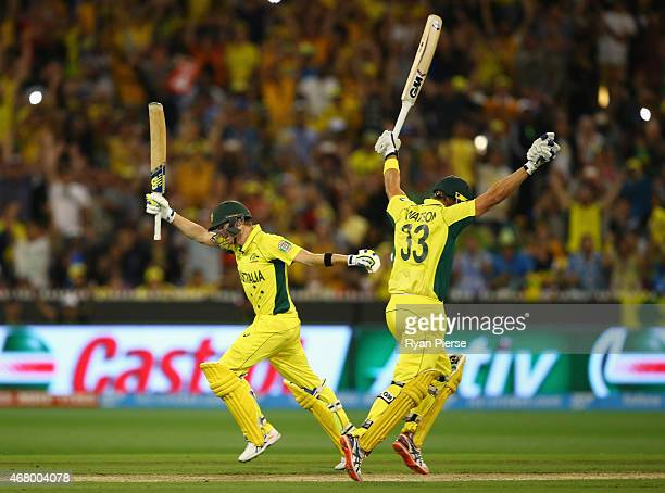 Steve Smith and Shane Watson of Australia celebrate victory after Smith hits the winning runs during the 2015 ICC Cricket World Cup final match...