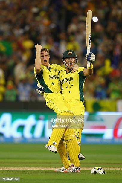Steve Smith and Shane Watson of Australia celebrate victory during the 2015 ICC Cricket World Cup final match between Australia and New Zealand at...