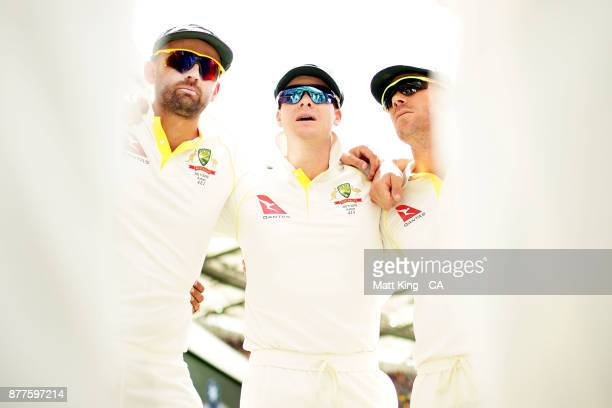 Steve Smith captain of Australia alongside Nathan Lyon and David Warner talks to players in a huddle prior to play during day one of the First Test...