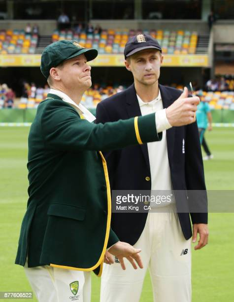 Steve Smith captain of Australia and Joe Root captain of England take part in the coin toss during day one of the First Test Match of the 2017/18...