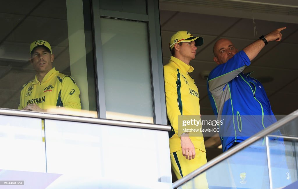 Steve Smith, Captain of Australia talks to Darren Lehmann, Coach of Australia, as David Warner looks on during a rain break during the ICC Champions Trophy match between England and Australia at Edgbaston on June 10, 2017 in Birmingham, England.