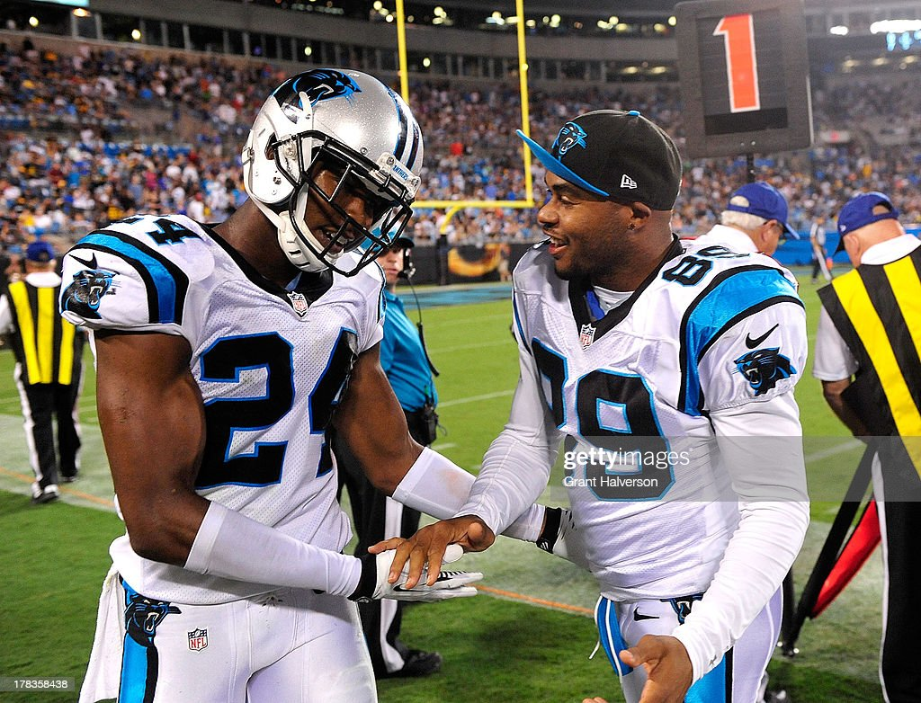 Steve Smith #89 congratulates Josh Norman #24 of the Carolina Panthers after Norman's second interception against the Pittsburgh Steelers during a preseason NFL game at Bank of America Stadium on August 29, 2013 in Charlotte, North Carolina. The Panthers won 25-10.