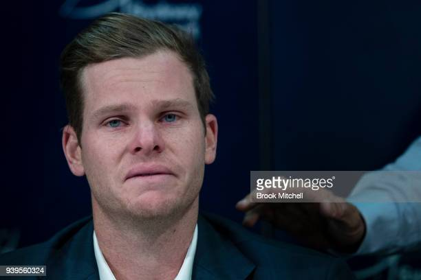 Steve Smith is comforted by his father Peter during a press conference at Sydney International Airport on March 29 2018 in Sydney Australia Steve...